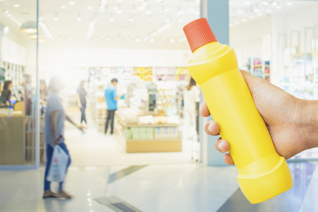 yellow bottle for cleaning staff in home blurred background Metaphor for cleaning Get rid of germs In bathroom, home office or industry.For reliability And satisfaction of service and customers