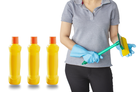 Female with yellow bottle for cleaning staff on isolated background Metaphor for cleaning Get rid of germs In bathroom, home office or industry.For reliability And satisfaction of service and customers