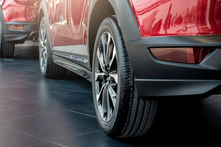 Suspension with rubber tires car.Close up for Inflated pressure gauge for car tyre pressure measurement for automotive, automobile image Stock Photo