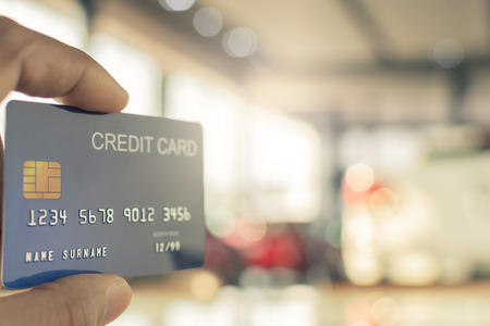 man holding credit card for blurred bokeh background e-shopping marketing digital, consumer purchase shopping internet online image Stock Photo