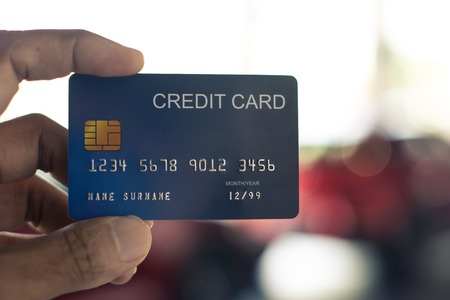 man holding credit card for car blurred bokeh background e-shopping    marketing digital, consumer purchase shopping internet online image Stock Photo