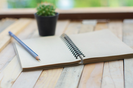 man business inspection Notepad with pencil on wood board background.using wallpaper for education, business photo.Take note of the product for book with paper and concept, object or copy space.
