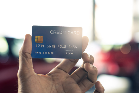 man holding credit card for car blurred bokeh background e-shopping  marketing digital, consumer purchase shopping internet online image