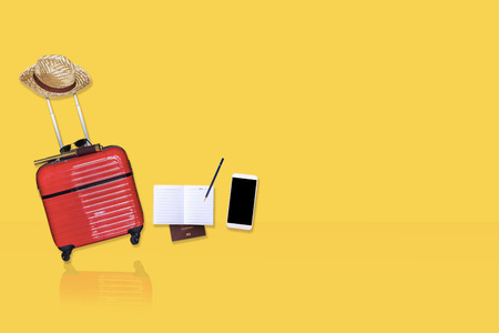 Red luggage with camera,  binoculars with hat on yellow isolated  background for activity lifestyle outdoors freedom or travel tourism andinspiration backpacker alone tourist image