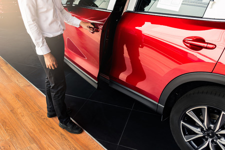 man open red car door with smart keyless For automotive or transportation image