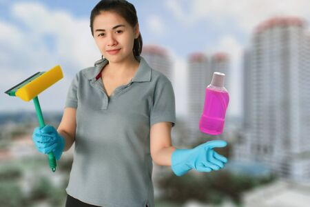 Female cleaning staff in bathroom blurred background Metaphor for cleaning Get rid of germs In bathroom, home office. For reliability And satisfaction of service and customers.
