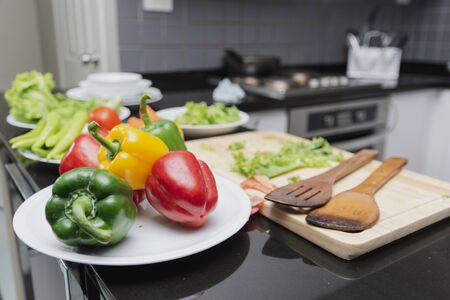 Vegetables on a plate for cooking salad food  with vegetable tomatoes and carrots, bell peppers for happy family cook food enjoyment lifestyle kitchen in home