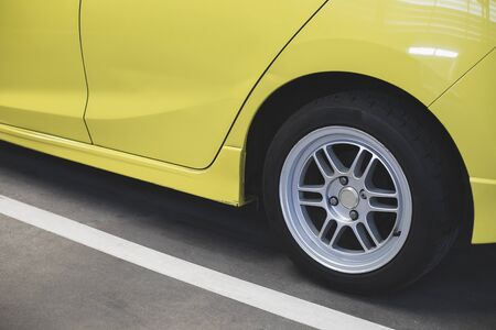 Suspension car yellow with Tire car for inspection Measure quantity Inflated Rubber tires car.Close up wheel pressure gauge for car tyre pressure measurement for automotive, automobile image Фото со стока