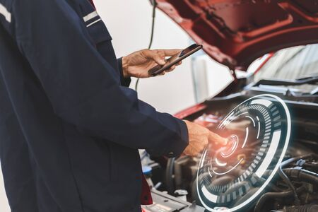 Asian Man mechanic inspection Shine a torch car engine checking bug in engine from application smartphone.Red car for service maintenance insurance with car engine.for transport automobile automotive auto repair car