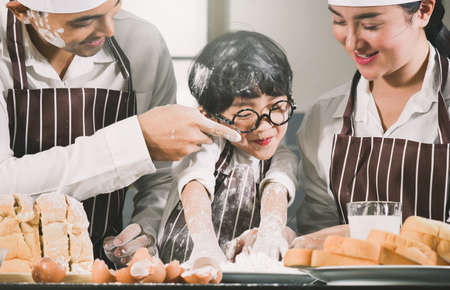 asian cooking bread family Parent child father mother child teamwork Kneading wheat flour so happiness enjoy bread cookie in room kitchen food homemade