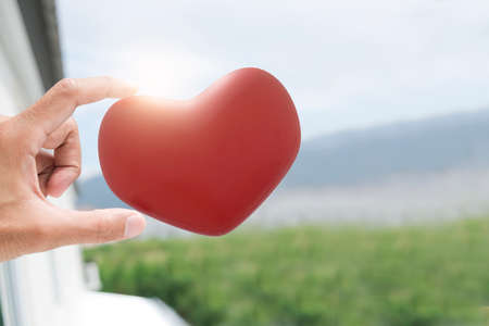 Man hand hold heart love valentine enjoyment to enjoyment communication dating online service for couple new normol during coronavirus covid-19. from application