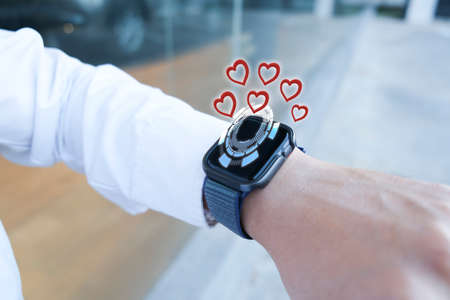 Man business smart watch with applications ai for love valentine enjoyment from smartphone enjoyment communication dating online service for couple new normol during coronavirus covid-19. from application