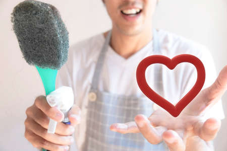 Asian male inspector smile to cleaning staff in bathroom disinfectant sprayers and germs  Metaphor for cleaning Get rid of germs In bathroom, home office.For reliability And satisfaction of love service
