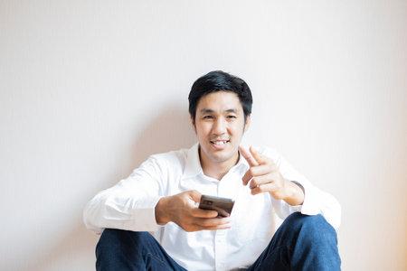 Asian man portrait confident teen studen lifestyle people For business insurance, salesman, finance, lifestyle and businessman portrait people communication image Stock fotó