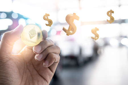 Asian man business holding tecnology bit coin in blurry office background. For business people, finance, lifestyle and ethereum or blockchain tecnology change to dollar