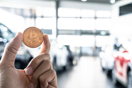 Asian man business holding tecnology bit coin in blurry office background. For business people, finance, lifestyle and ethereum or block chain tecnology image