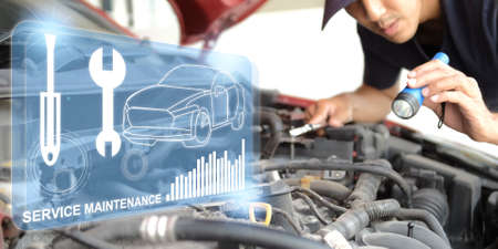 Asian Man mechanic inspection Shine a torch car engine checking bug in engine.red car for service maintenance insurance with car engine.for transport automobile automotive Standard-Bild