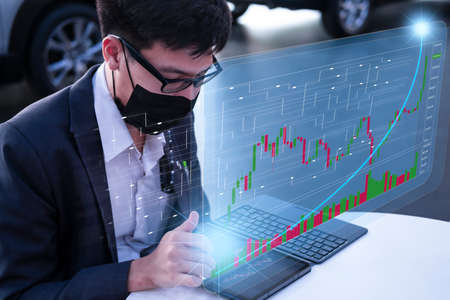 Asian man business holding tecnology graph bitcoin. For business stock market finance, lifestyle and ethereum or block chain tecnology change to dollar Stock market