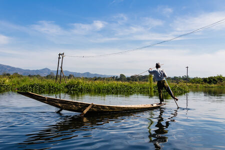 Fisherman with Leg rowing ,  inle lake in Myanmar  Burmar  photo