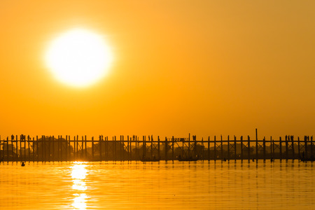 teakwood: Sunset at U Bein Teakwood Bridge  , Amarapura in Myanmar  Burmar