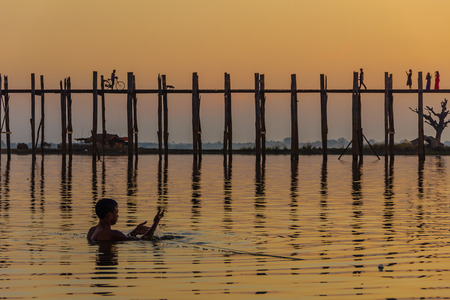 teakwood: Fisherman and Sunset at U Bein Teakwood Bridge  , Amarapura in Myanmar  Burmar