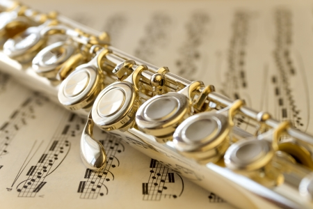 musicality: Music sheet and silver flute