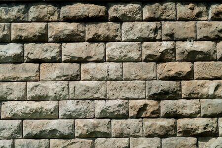 porosity: Wall of gray porous stone