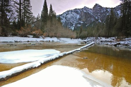 merced: This is the snow capped three brothers in Yosemite and merced river Stock Photo