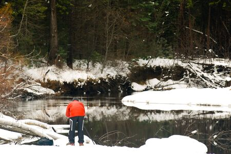 merced: This is a photographer taking photo of the frozen Merced River in Yosemite National Park Stock Photo