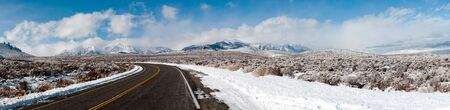 This is a panorama of the mountain ranges near mono lake, in Winter. Stock Photo