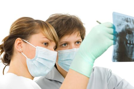 dental hygiene: Two sweet young doctor examine the dental Rx