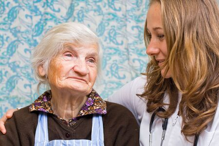 Old woman tells a story to the young doctor Stock Photo - 6666890
