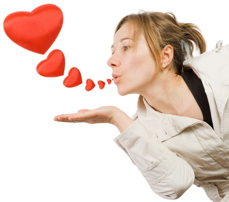 Young lovely girl with big red hearts on white background. Stock Photo - 17632078