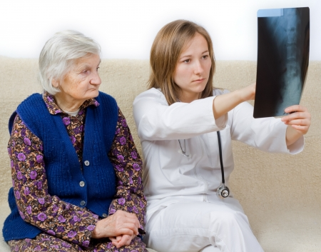 Young doctor tells the diagnosis to the old woman Stock Photo - 17632347