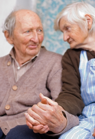 elderly hands: Old happy grandparents staying together