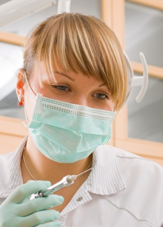 hypodermic syringe: Young sweet dentist whit the injection Stock Photo