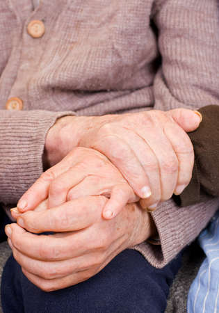 positiveness: Old couple holding the hands