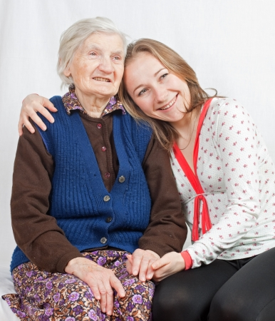 positiveness: Vieja mujer y la ni�a dulce Foto de archivo