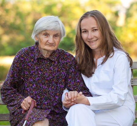 Elderly woman with the young sweet doctor Stock Photo - 18006939