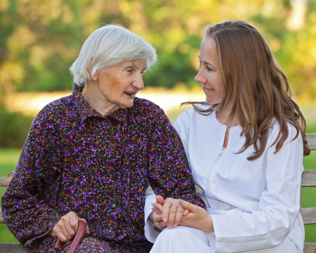 elderly care: Elderly woman with the young sweet doctor