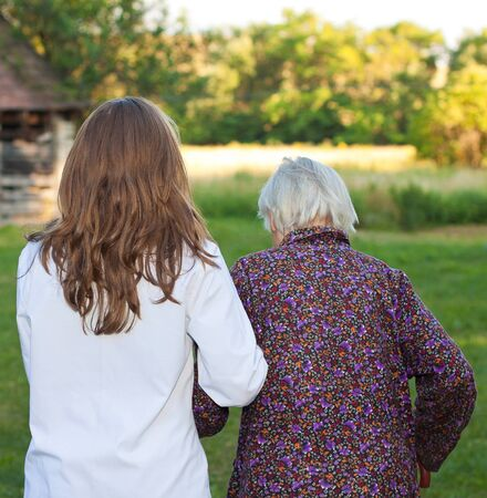Elderly woman with the young sweet doctor Stock Photo - 18006937