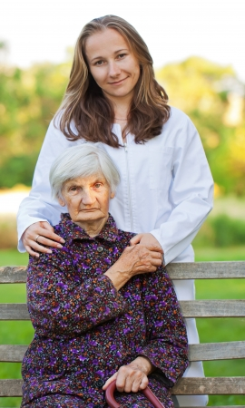Elderly woman with the young sweet doctor Stock Photo - 18006929