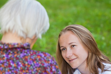Elderly woman with the young sweet doctor Stock Photo - 18006942