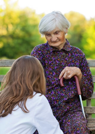 Elderly woman with the young sweet doctor Stock Photo - 18006927