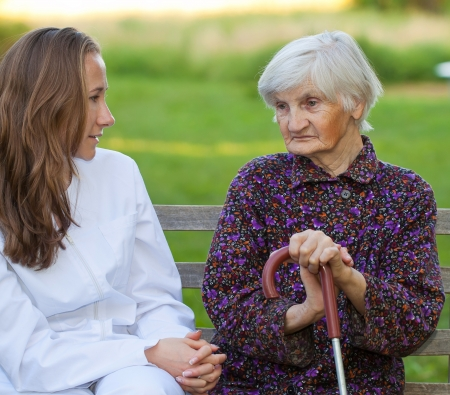 Elderly woman with the young sweet doctor Stock Photo - 18006935