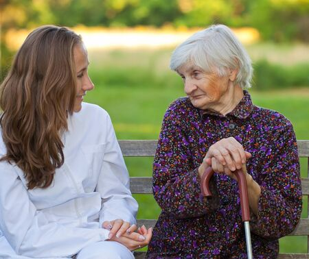 Elderly woman with the young sweet doctor Stock Photo - 18006945
