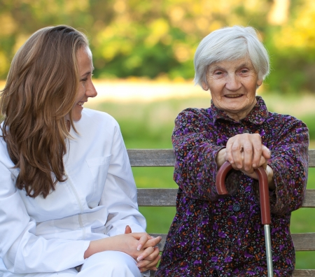 Elderly woman with the young sweet doctor photo