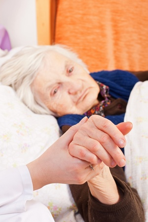 Elderly woman with the young doctor Stock Photo - 18068694