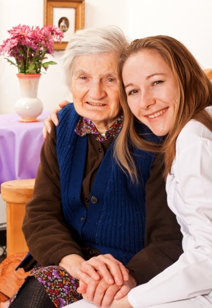 old age care: Young doctor holds the old womans hands