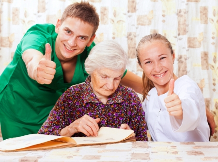 Elderly woman with the sweet young doctors Stock Photo - 18068704